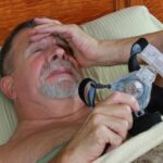 man having problems with CPAP medical device